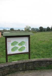 Each station features a sign outlining some aspect about the battle. In this case four differing theories about the localization of the battlefield are presented.